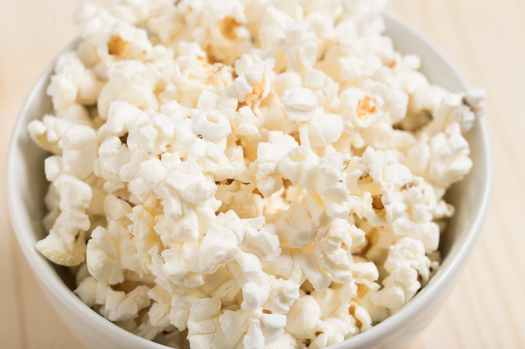 white bowl of popcorn