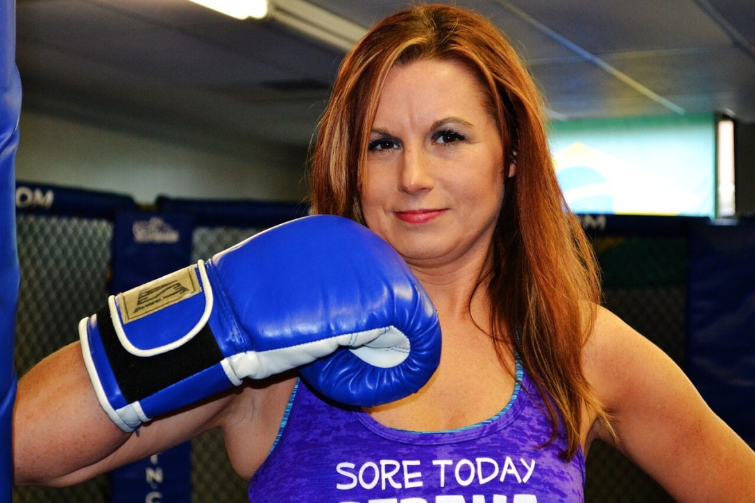 adult woman wearing boxing glove