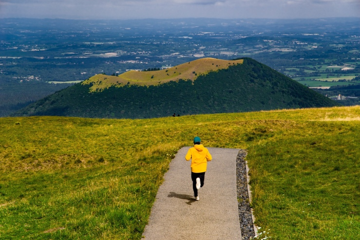 Runner on rolling, green hills