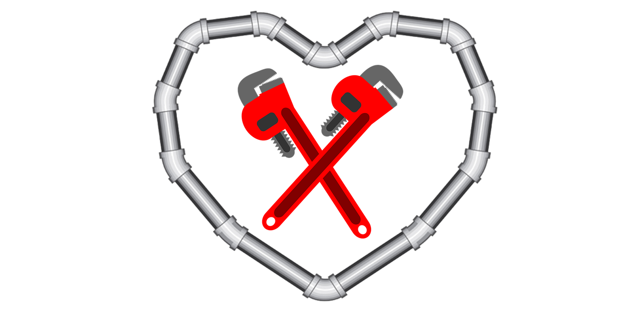 pipes configured in a heart shape with two red monkey wrenches criiss-crossed in the middle