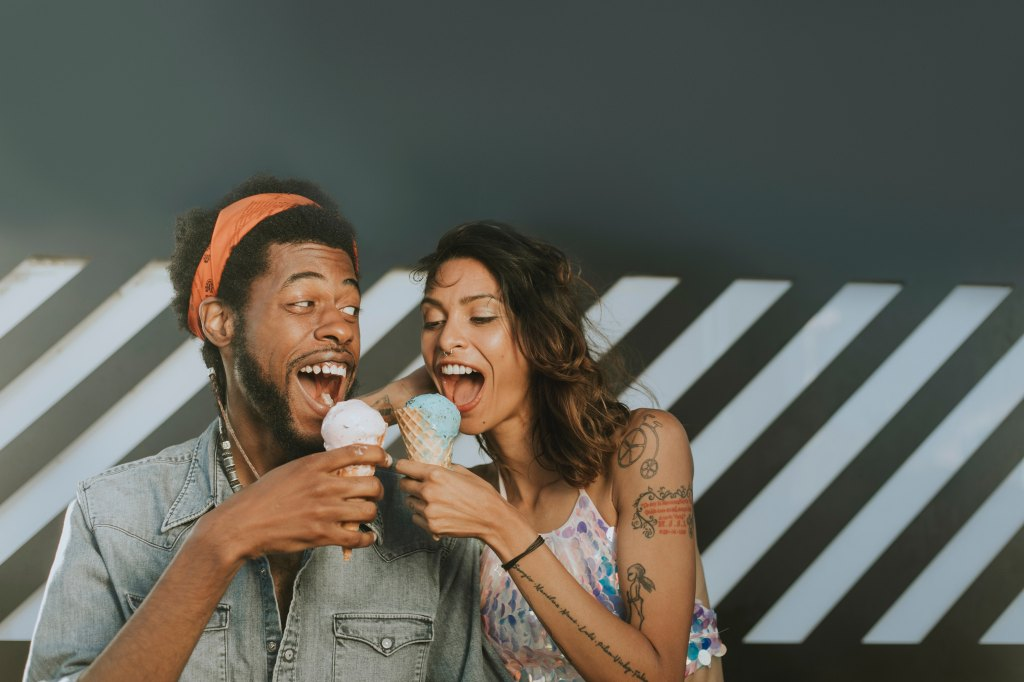 man and woman eating ice cream cones together