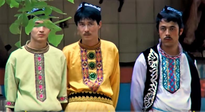 frowning Uyghur men in ethnic costume