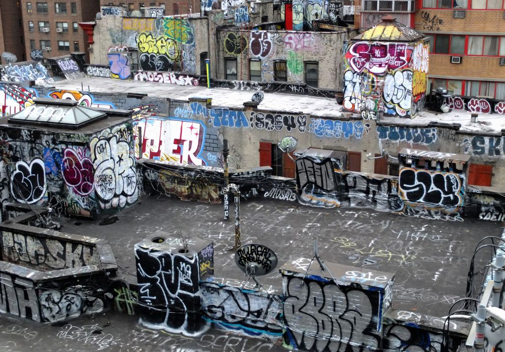 vandalized rooftops in urban environment