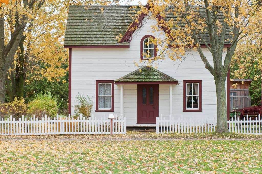 single-family home with white picket fence